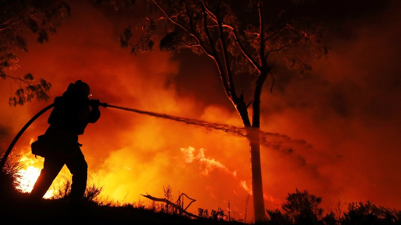 First death reported in raging California wildfires