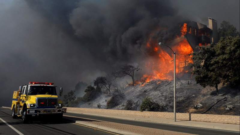 Burned-out homes await residents in fire-ravaged California