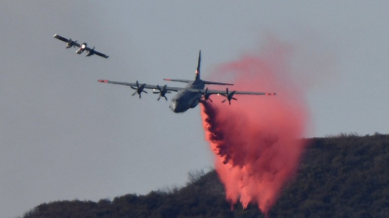 Firefighters race to contain California wildfires