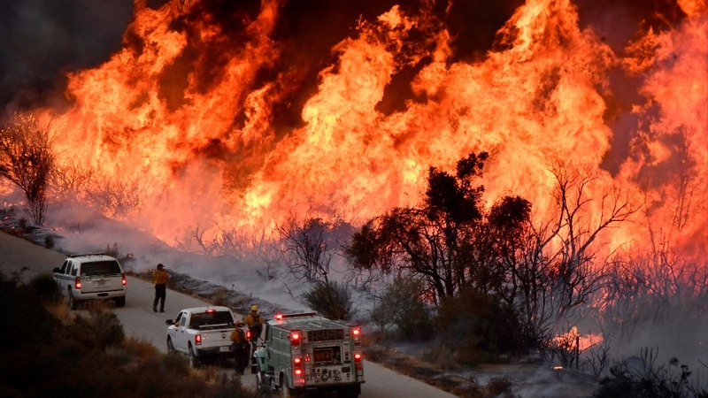 Crews battling California wildfires brace for return of high winds