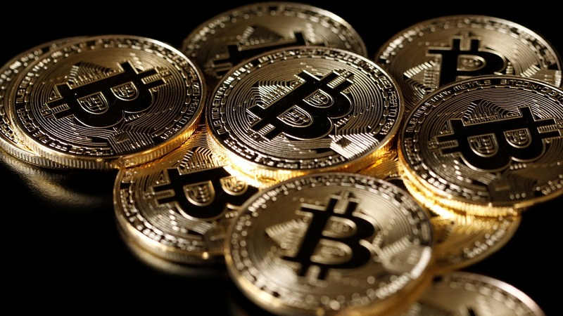Hotly anticipated bitcoin futures surge on debut