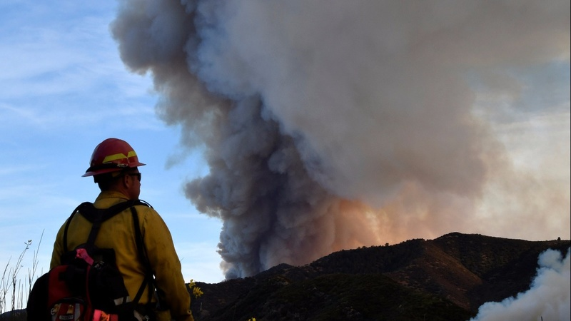 California wildfire rages, threatens communities
