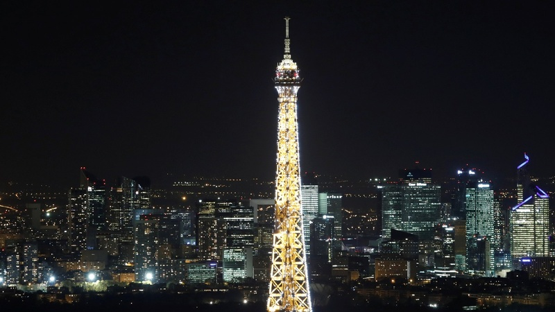 INSIGHT: Paris' Eiffel Tower gets festive