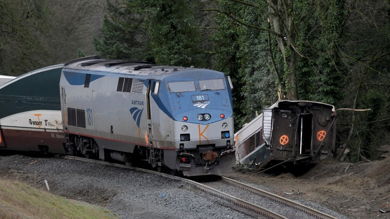 Crews work to clear derailed Washington train