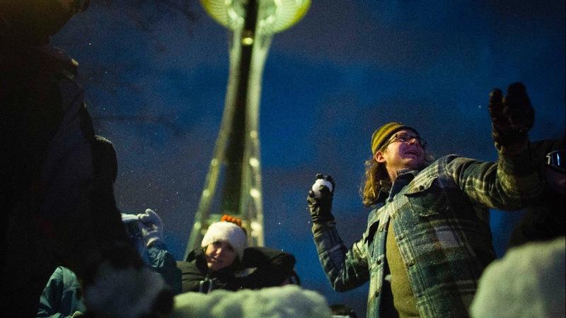 Rare snowfall sends cars slipping through Seattle