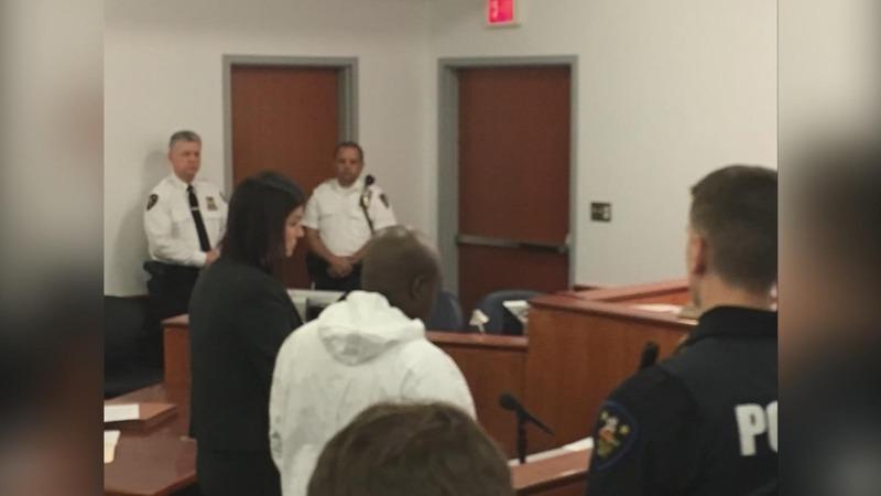 Two men arraigned in New York quadruple homicide case