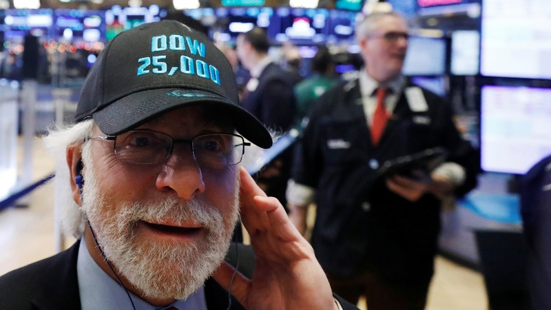 Dow breaks 25,000 milestone in global stock surge