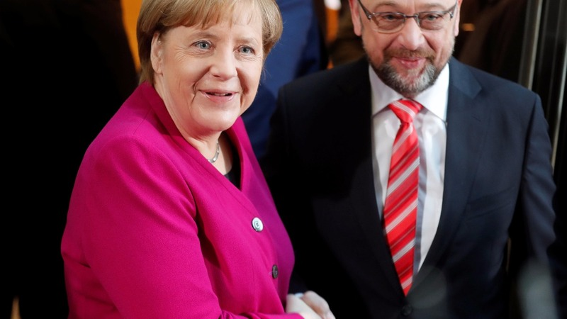 Merkel drops climate target to secure deal