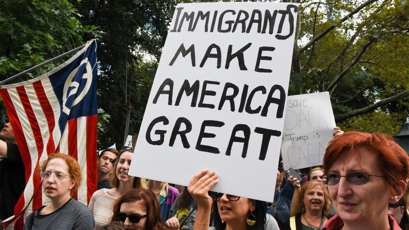 Judge blocks Trump move to rescind DACA