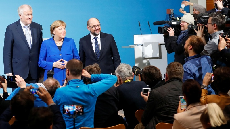 Merkel unlocks key to coalition talks