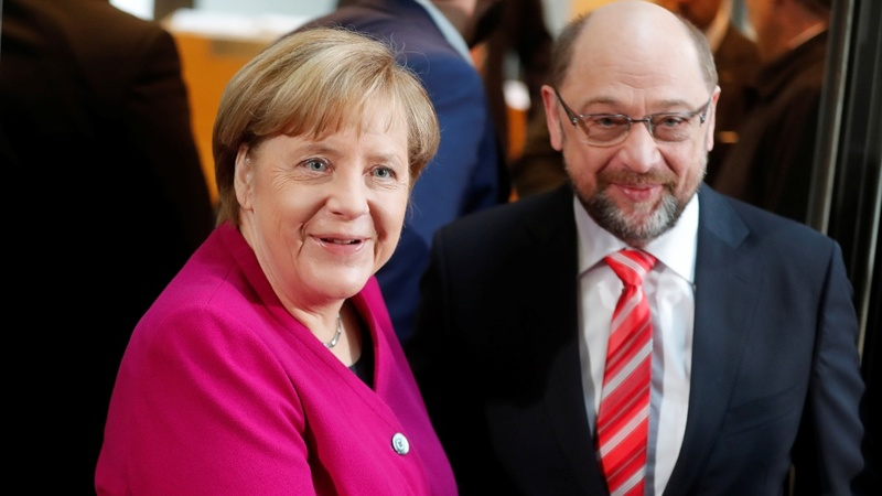 German SPD votes for coalition talks with Merkel