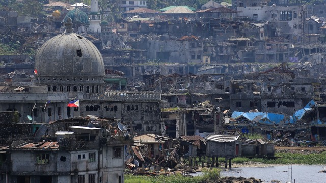 Image result for Community leaders survey damaged houses and buildings inside war-torn Marawi, Philippines January 13, 2018, photos