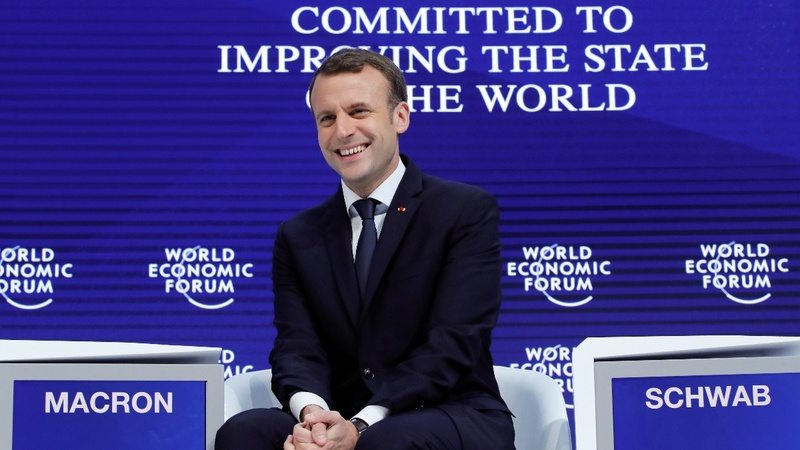 Macron, Merkel lay out anti-Trump strategy in Davos