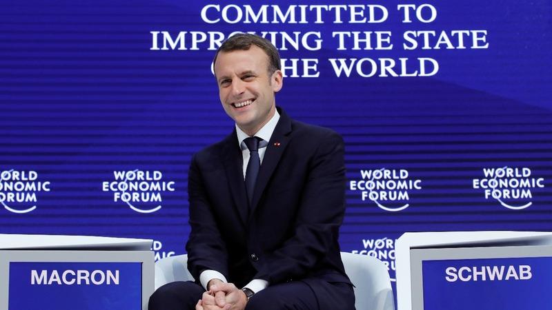 Macron, Merkel lay out anti-Trump strategy in Davos