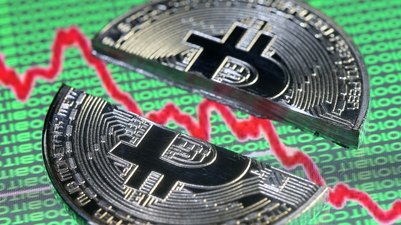 Bitcoin slides below $9,000