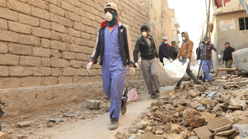 Battle over bodies in Iraq's Mosul, long after I.S. defeat