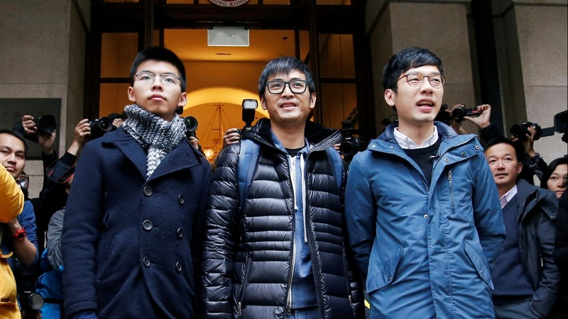 Hong Kong court lets democracy activists walk free