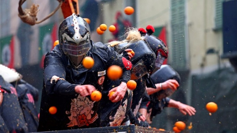 INSIGHT: Italians attend 'Battle of the Oranges'