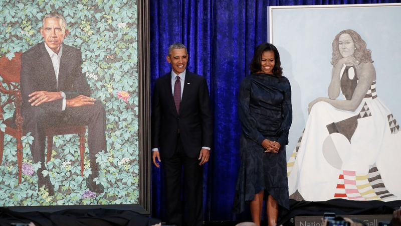 INSIGHT: The Obamas attend the unveiling of their official portraits