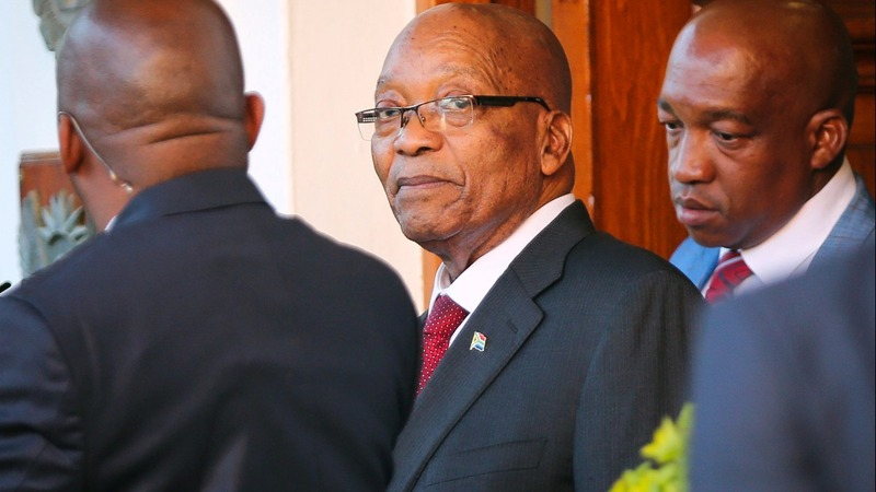 South Africa's beleaguered Zuma hangs on