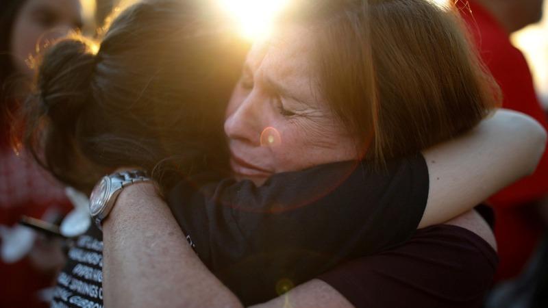 INSIGHT: Thousands grieve at Florida shooting vigil