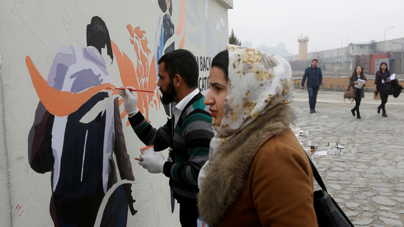 INSIGHT: Afghanistan artists paint walls for social change