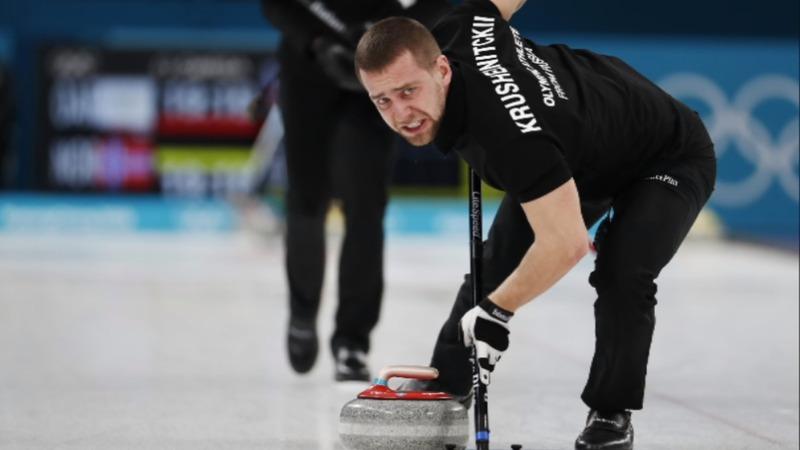 Russian medalist denies doping as probe begins