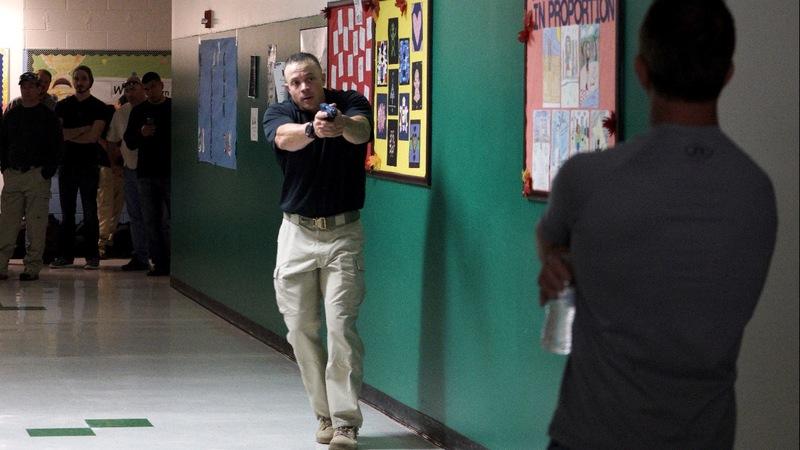 Amid calls for gun laws, Trump touts armed teachers