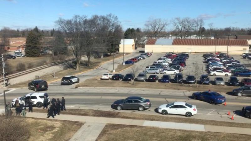 Police seek suspect in Michigan university shooting