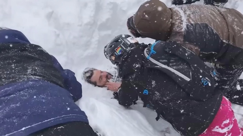 Skiers use bare hands to dig man out of avalanche