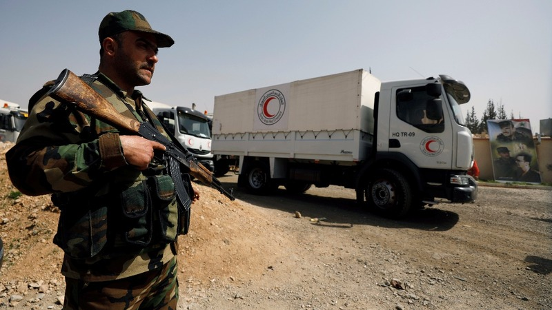Aid convoy reaches Syria's Ghouta amid fighting