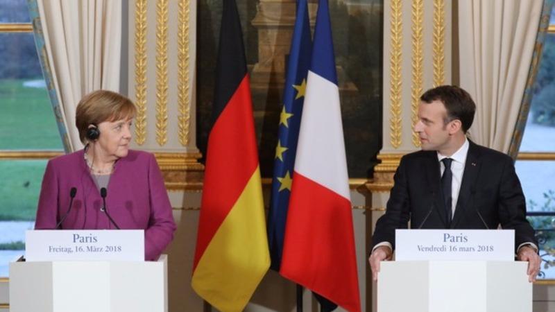Merkel and Macron promise EU reform by June