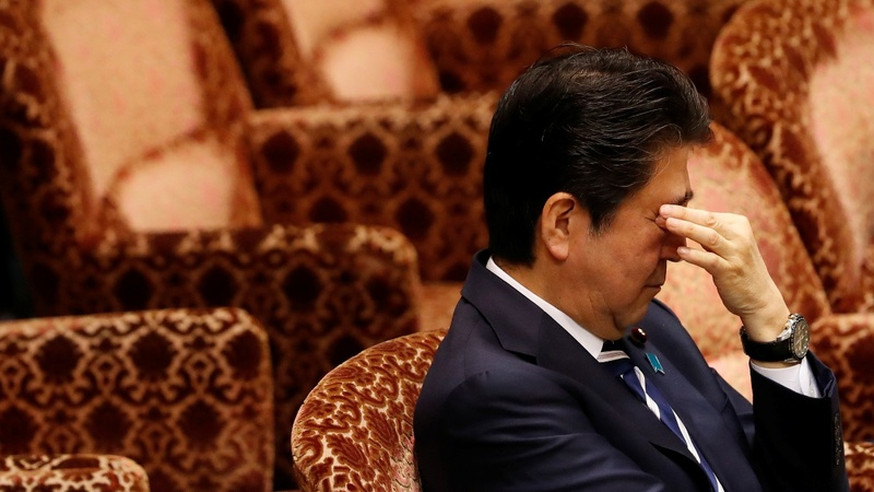 As scandal deepens, support for Shinzo Abe shrinks