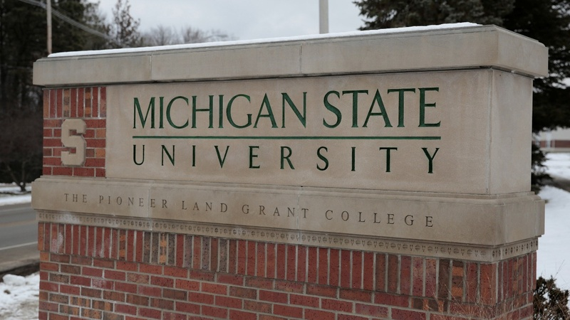 Ex-Michigan State dean charged with sex crime
