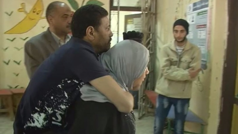 An Egyptian couple make voting a team effort
