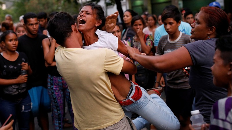 Venezuelan prison riot and fire leaves at least 68 dead