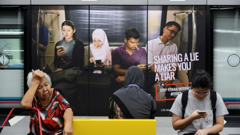 Malaysia outlaws 'fake news' ahead of elections