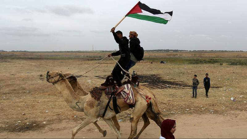 Merchants return to Gaza-Israel border, but with risks