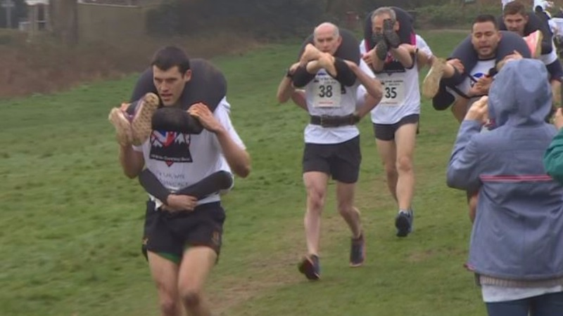 INSIGHT: Wacky wife-carrying race kicks off in UK