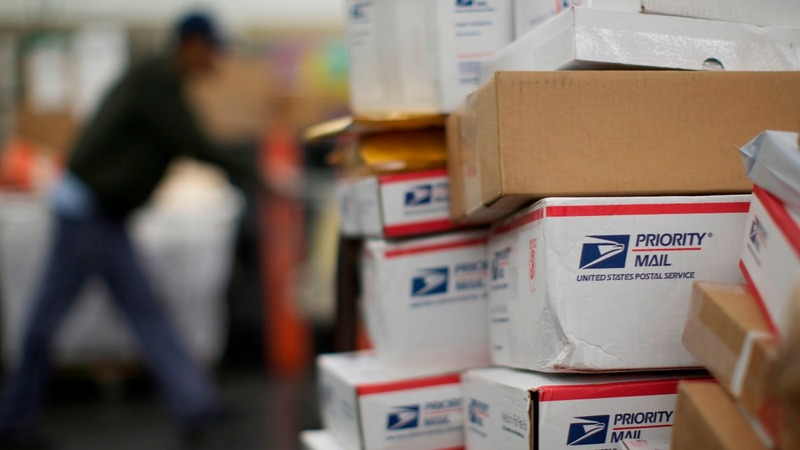 After slamming Amazon, Trump orders Postal Service review