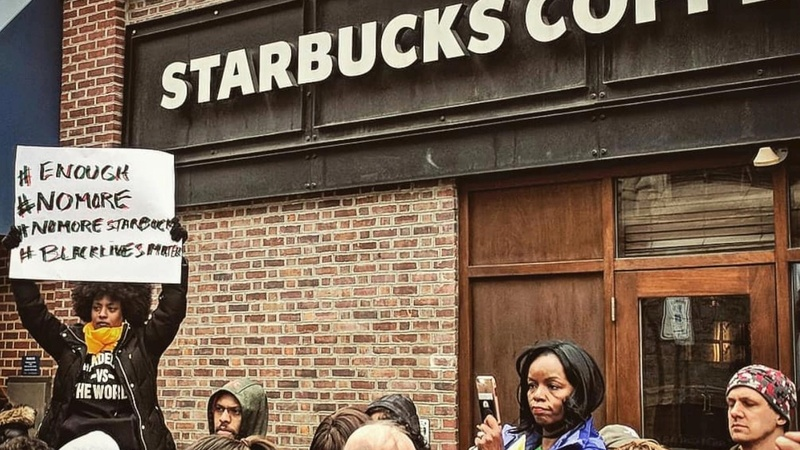 Starbucks apologizes for arrests of two black men