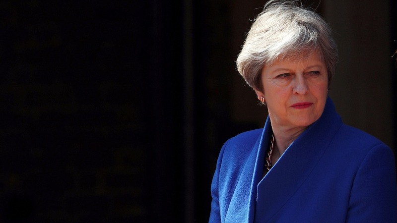 UK's May tries to shut down immigration scandal