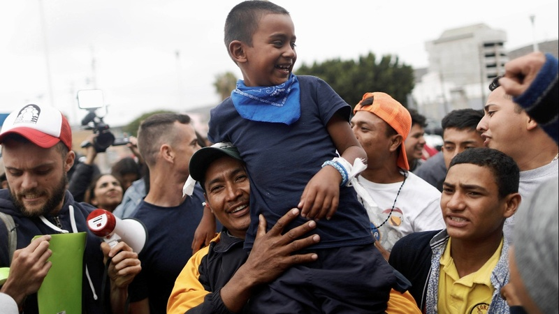 First asylum seekers from 'caravan' enter U.S.