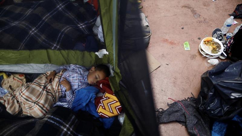 'Caravan' migrants wait and see as few reach U.S.