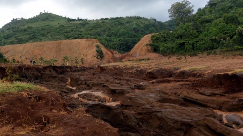 Kenyan police examine burst dam after dozens die