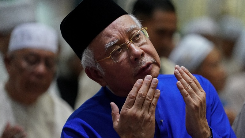 Malaysia's ex-PM banned from leaving the country