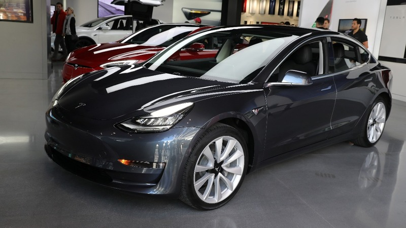 Elon Musk plans to reorganize Tesla