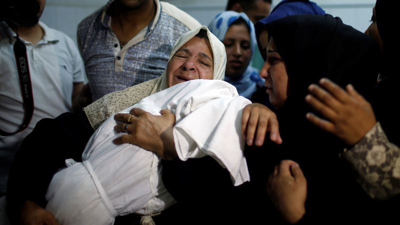 Gaza simmers as dead protesters are buried