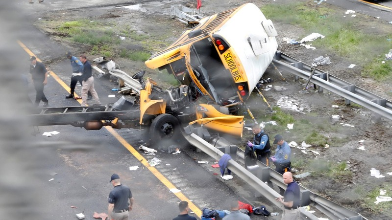 At least two dead in school bus highway accident