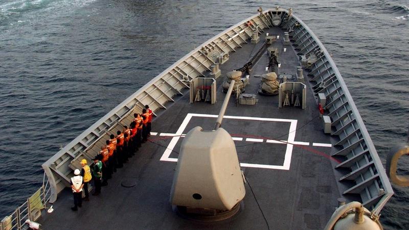 U.S. warships sail near islands claimed by Beijing